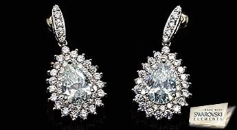 """Neticami skaisti auskari """"Sniegbaltīte"""", izpildīti klasiskā stilā ar inkrustāciju no liela daudzuma caurspīdīgiem Swarovski™ kristāliem."""