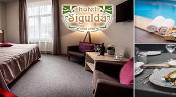"""SIGULDA: Atpūta DIVIEM (1 nakts) ar brokastīm, vakariņām un atpūtas kompleksa apmeklējumu (sauna, tvaika pirts, SPA vanna, baseins) viesnīcā """"Sigulda"""""""